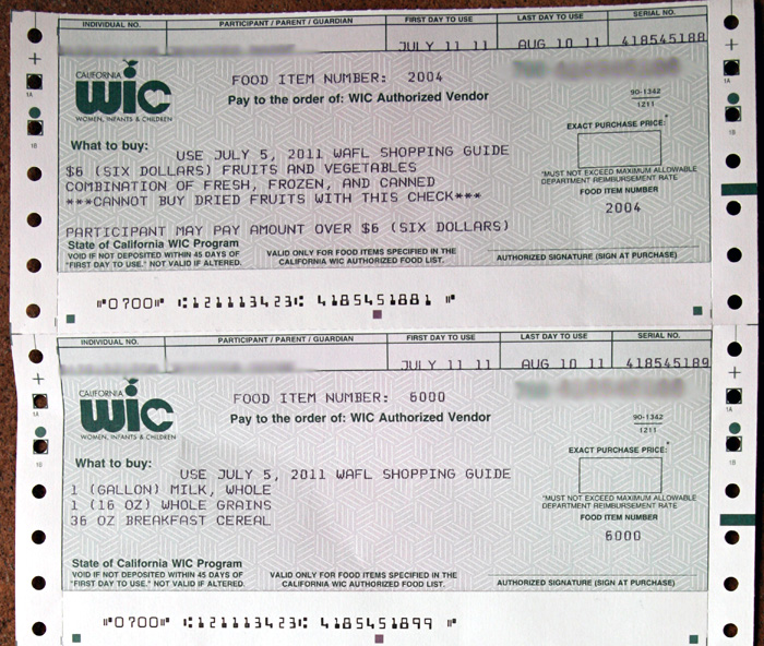 A WIC participant displays his daughter's WIC vouchers at the Richmond, CA WIC office in July 2011. THE RATION/Felix Irmer